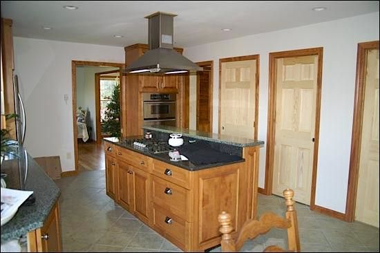 Hahn Appliance for a Traditional Kitchen with a Medium Wood Cabinets and Kitchens by Hahn Construction