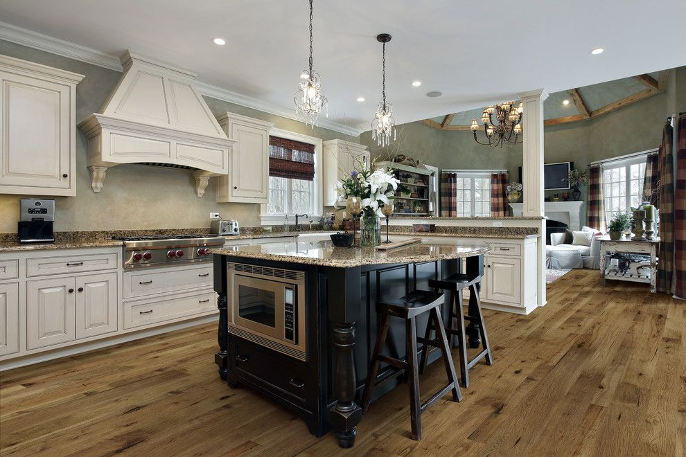 Hallmark Hardwoods for a Traditional Kitchen with a Granite Countertop and Rustic Contemporary Kitchen Design with Monterey Floors by Hallmark Floors