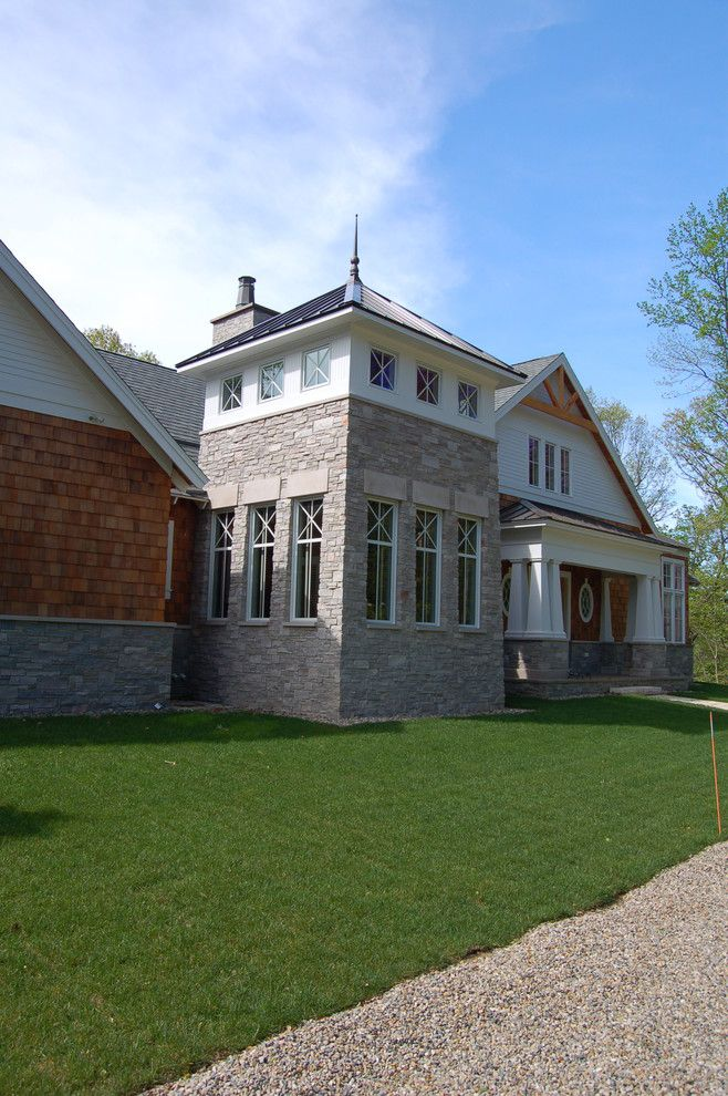 Halquist Stone for a Craftsman Exterior with a Cedar Shingles and Exterior Images by Hibler Design Studio