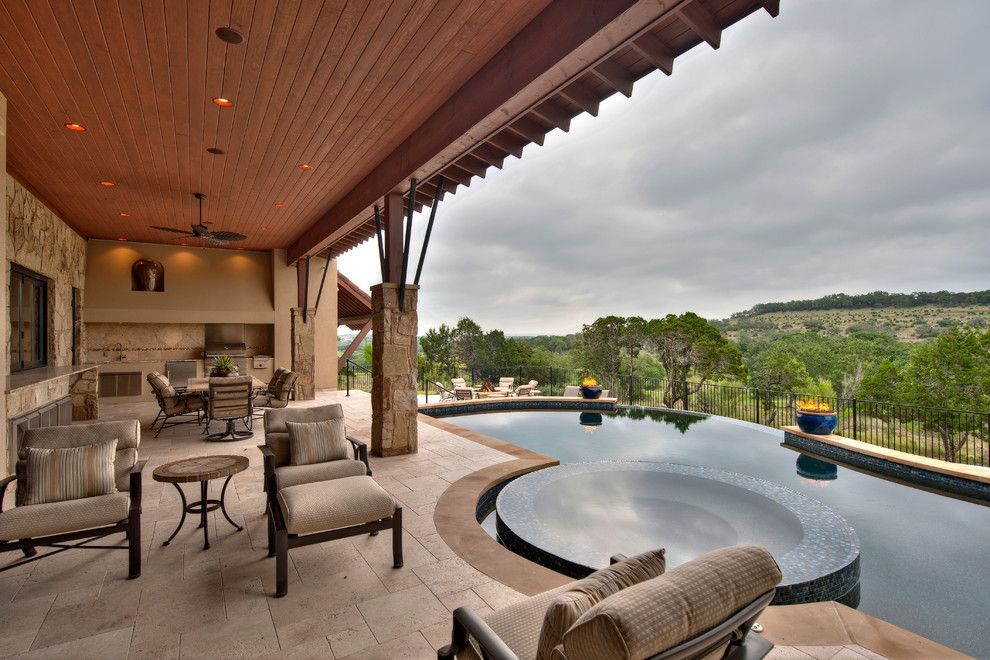 Hammary for a Mediterranean Pool with a Mosaic Tile Pool and Award Winning Projects by Jenkins Custom Homes