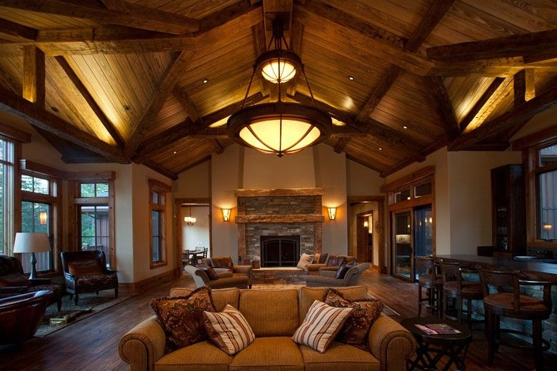Hammerton Lighting for a Traditional Living Room with a Stacked Stone Fireplace and Chateau Collection by Hammerton Lighting