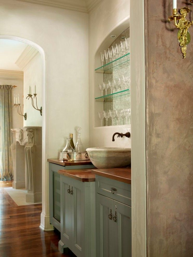 Handsome Cabinets for a Traditional Home Bar with a Stone Vessel and Simple Elegance by Glen Alspaugh Kitchens and Baths
