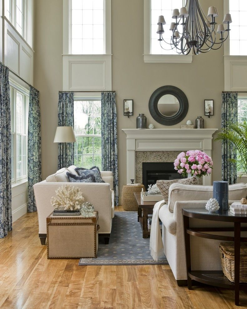Hanks Furniture for a Traditional Living Room with a Beige Fireplace Mantel and Cathedral Living Room by Jtm Interiors, Llc