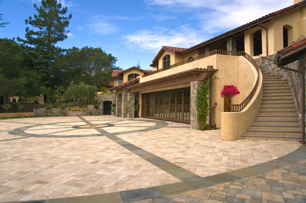 Hanover Pavers for a Mediterranean Exterior with a Trellis and Saratoga Estate by Kikuchi + Kankel Design Group