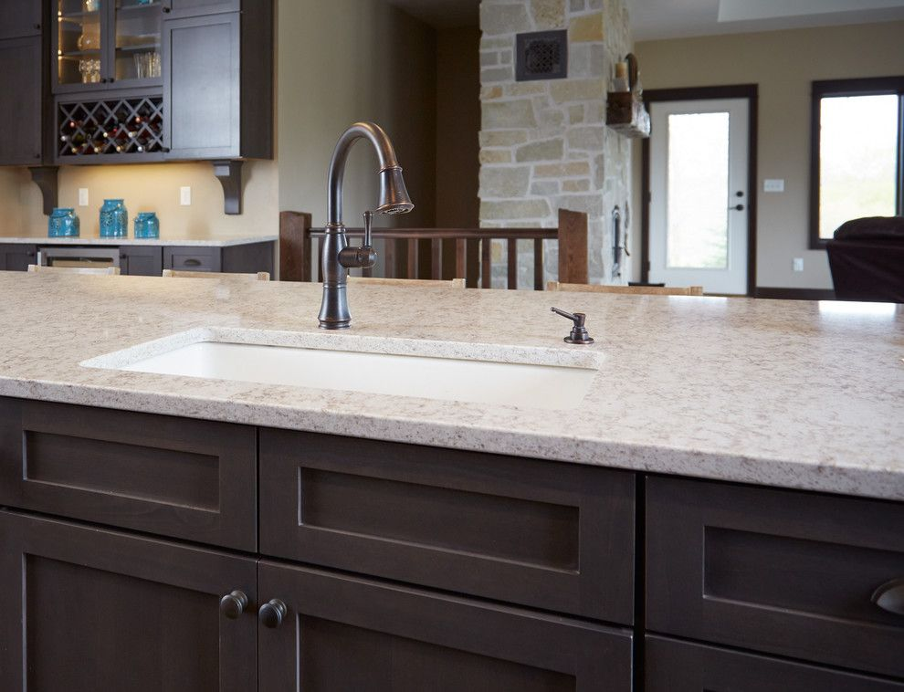 Hanstone for a Modern Kitchen with a Countertops and Oil Rubbed Bronze Faucet & Soap Dispenser by Gerhard's Kitchen & Bath Store