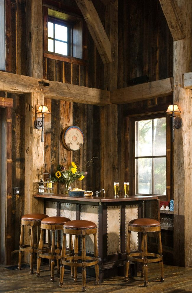 Heritage Homes Fargo for a Rustic Home Bar with a Leather Barstools and Heritage Cabin by Rmt Architects