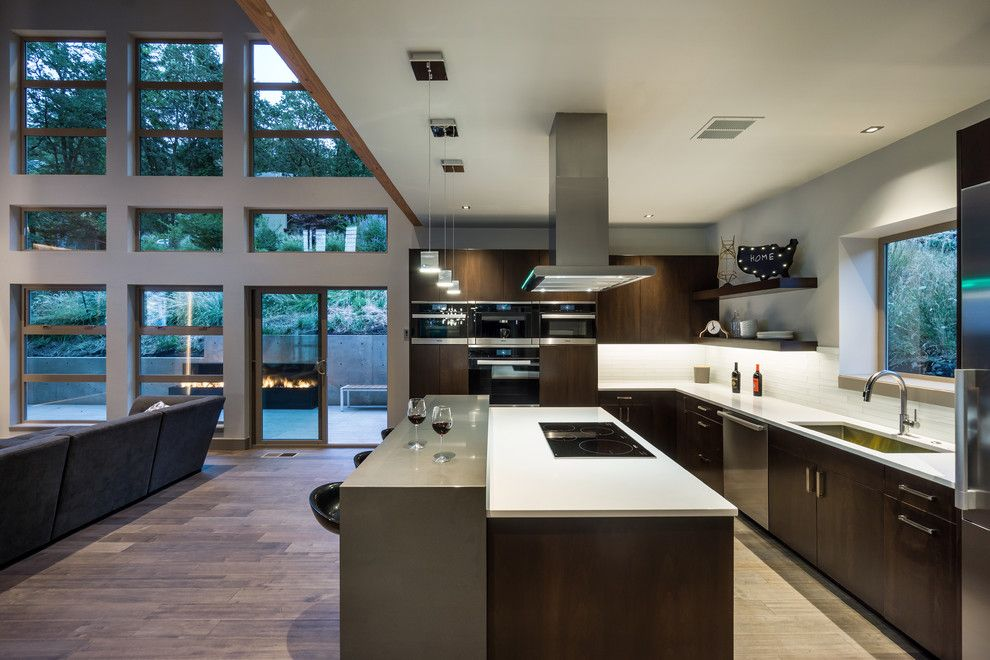 Hermitage Lighting for a Contemporary Kitchen with a Floor to Ceiling Windows and Partnering with Jordan Iverson by Maxim Lighting International