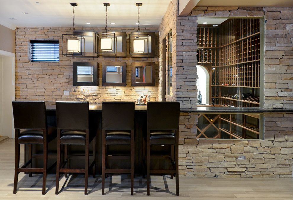 Hermitage Lighting for a Contemporary Wine Cellar with a Counter Stools and Hermitage Residence by Besch Design, Ltd.