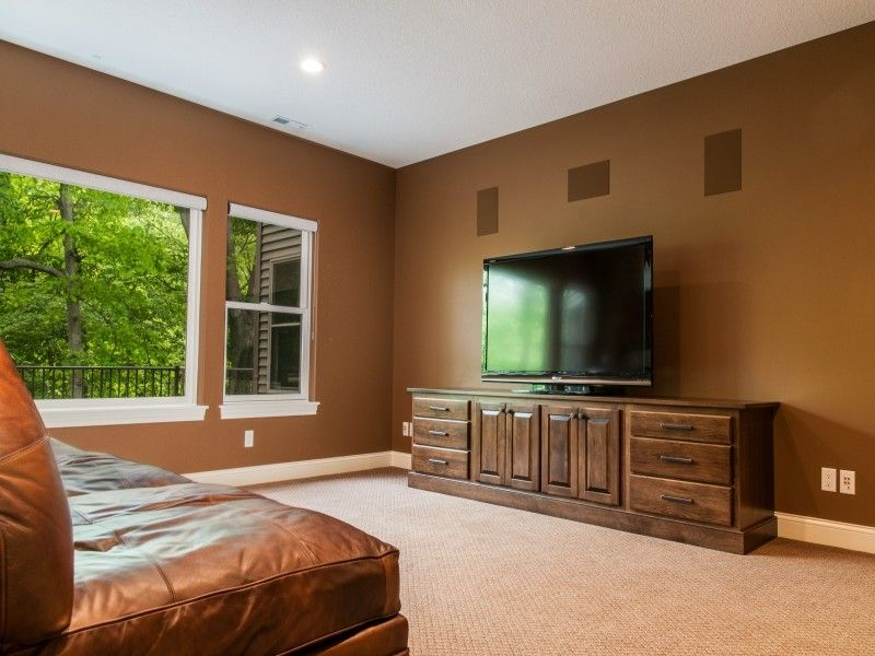 h&h Homes for a Modern Family Room with a Brown Leather Sofa and 960 Highland Park by H&H Home Builders Inc