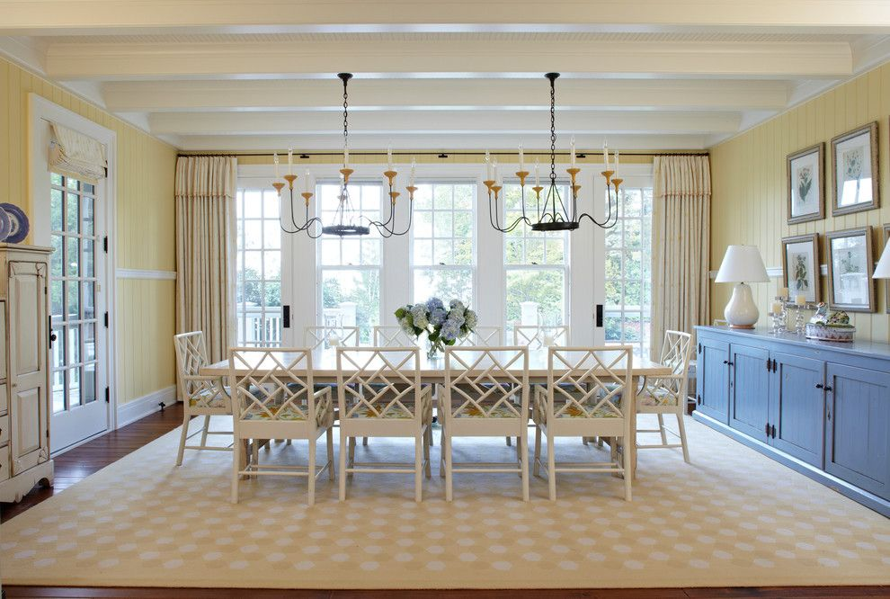 Hickory Chair for a Beach Style Dining Room with a Chandelier and Michigan Summer Home by Tom Stringer Design Partners