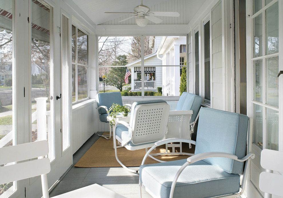 Highland House Furniture for a Beach Style Porch with a Beach House and PORCH by Sheila Rich Interiors, LLC