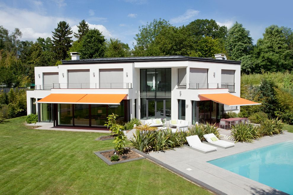 Hillside Landscaping for a Modern Exterior with a White Siding and Somfy by Somfy