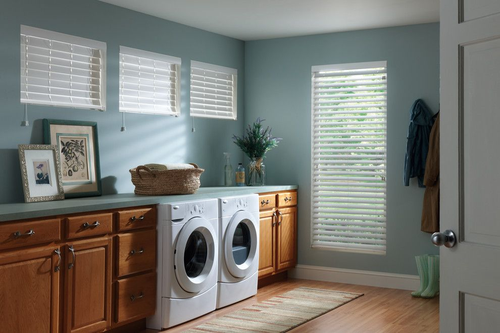 Hive Modern for a Traditional Laundry Room with a Wood Blinds and White Faux Wood Blinds by Budget Blinds