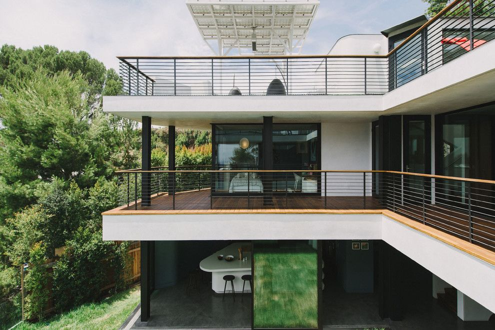 Holden Roofing for a Modern Exterior with a Three Story House and Green Greenberg Green House by New Theme Inc.