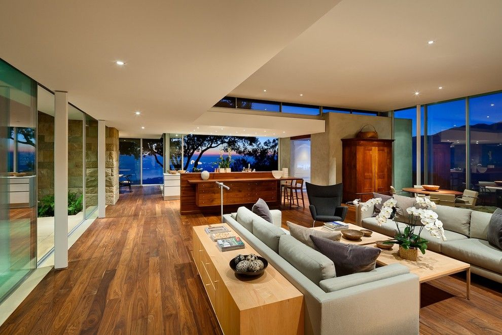 Holden Roofing for a Modern Family Room with a Wood Floor and Carpinteria Foothills Residence by Neumann Mendro Andrulaitis Architects Llp