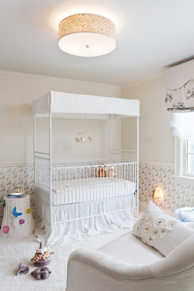 Holland and Sherry for a Traditional Nursery with a White Crib and Greenwich Modern Tudor by Marks & Frantz Interior Design
