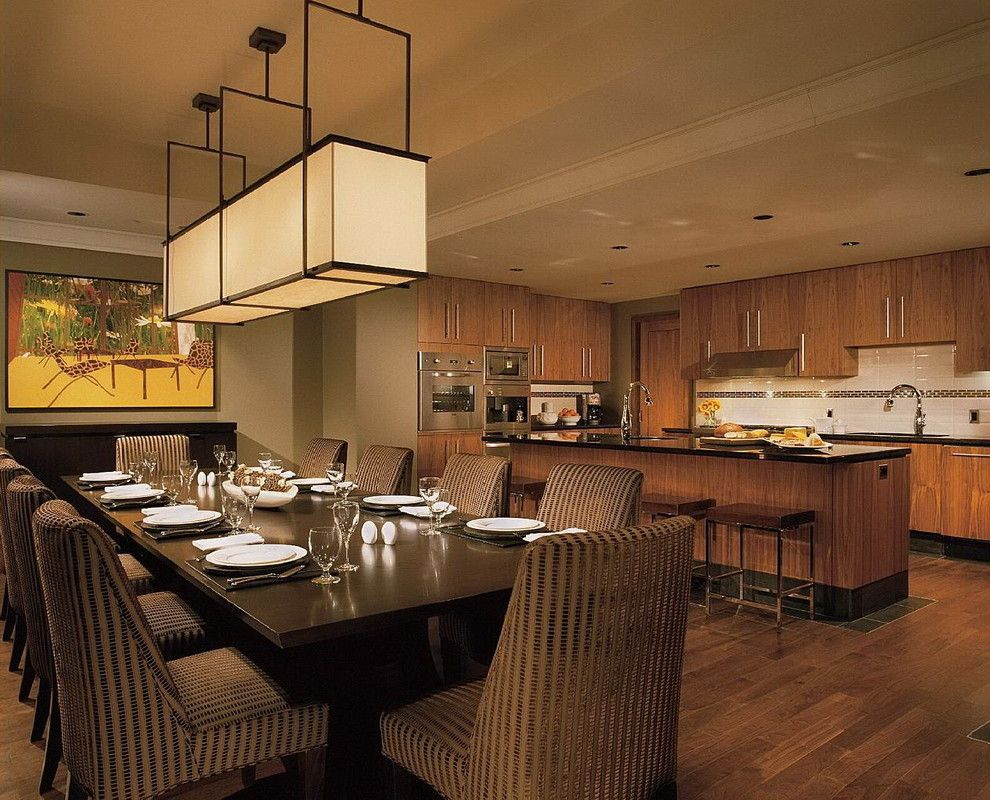 Holly Hunt Lighting for a Contemporary Kitchen with a Table Setting and While at Chil Design Group by Claudia Leccacorvi