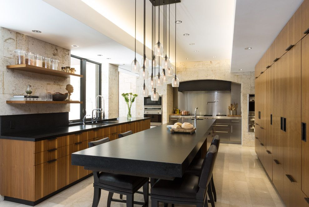Holly Hunt Lighting for a Modern Kitchen with a Wolf Range and Modern Scientist Residence by Touzet Studio