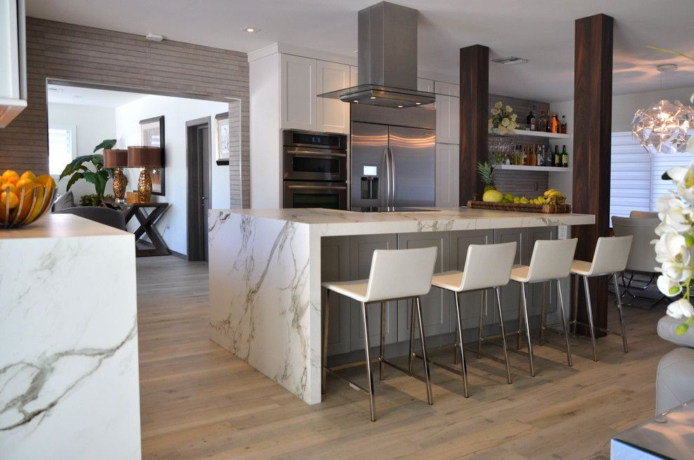 Homecrest Cabinetry for a Beach Style Kitchen with a Waterfall Counter and BUNGALOW by KabCo Kitchens