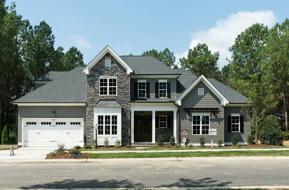 Homes by Dickerson for a Traditional Exterior with a Flagstone and the Oakmont Built by Homes by Dickerson at Carrie's Reach & Heritage by Homes by Dickerson