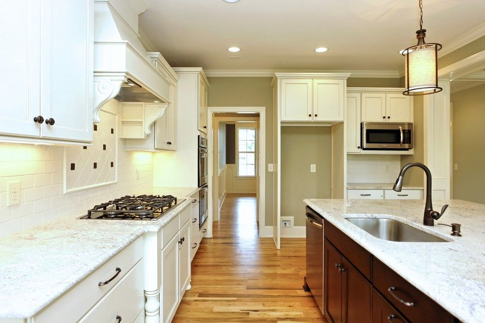 Homes by Dickerson for a Transitional Kitchen with a Dark vs Light Cabinets and the Madison Built by Homes by Dickerson by Homes by Dickerson