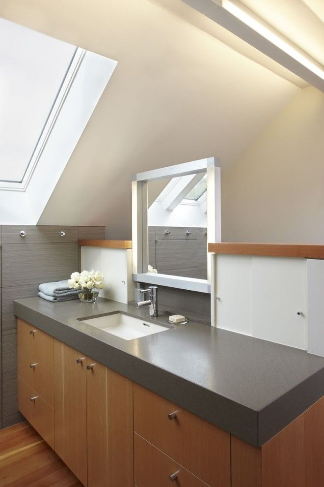Honed Granite for a Contemporary Bathroom with a Bathroom Hardware and Bathroom with Skylight by Mn Builders