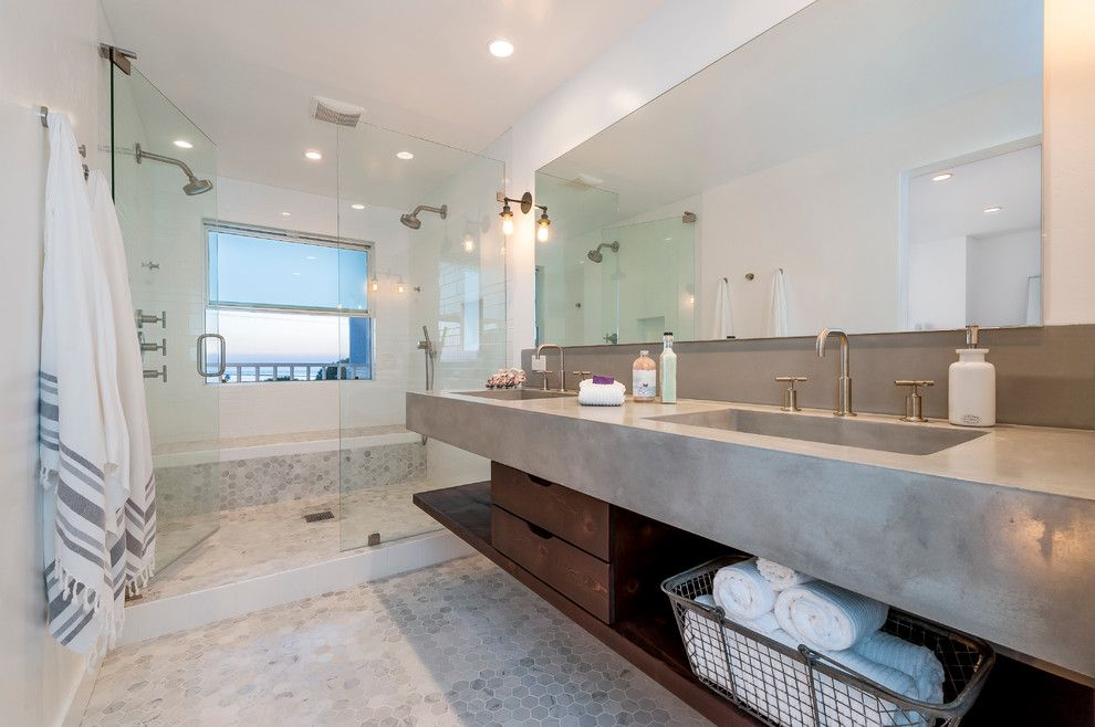 Honed Marble for a Beach Style Bathroom with a Beach Home and Cardiff Mid-Century Modern Beach House by Nena Aziz Interiors