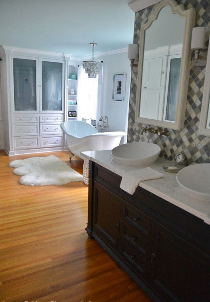 Honed Marble for a Traditional Bathroom with a Moen and Pittsford, Ny Traditional White Bathroom by Innovations by Vp