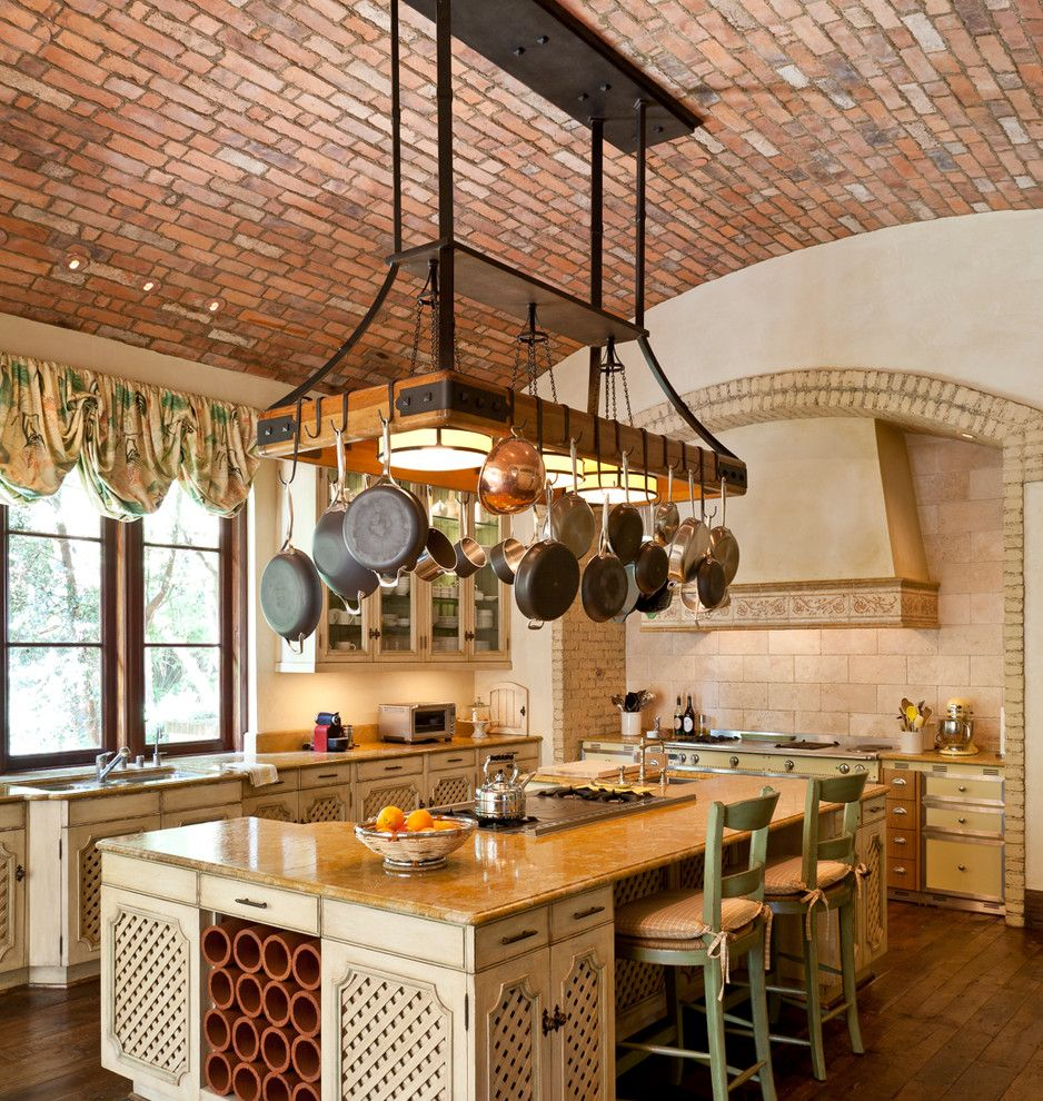 Hooks and Lattice for a Mediterranean Kitchen with a Brick and Brentwood by Sinclair Associates Architects