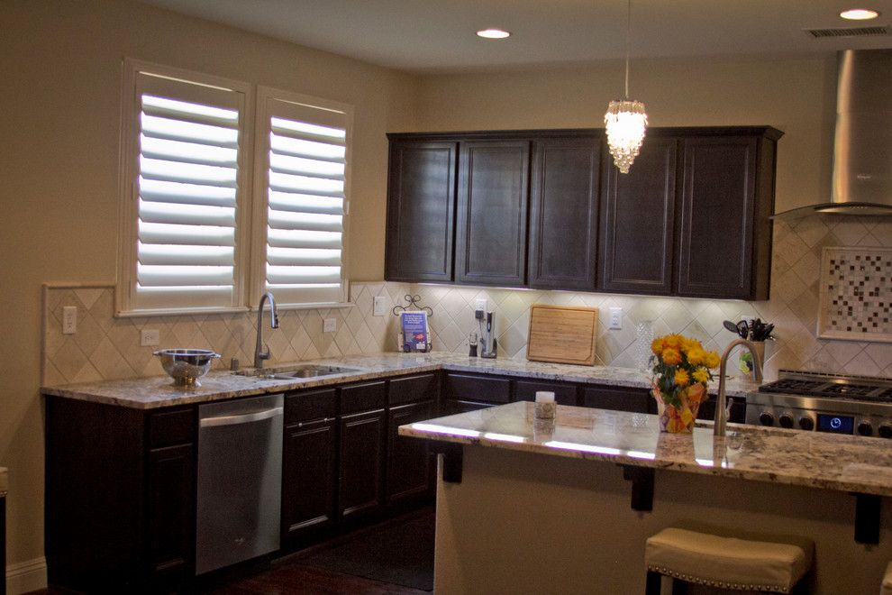 Horizons Window Fashions for a Traditional Kitchen with a Composite Shutters and Plantation Shutter Projects by Horizon Window Fashions