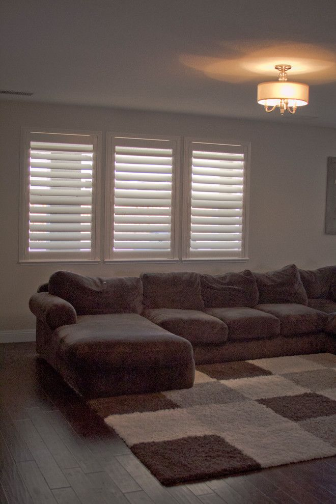 Horizons Window Fashions for a Traditional Living Room with a Shutters and Plantation Shutter Projects by Horizon Window Fashions