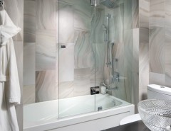 How to Clean Glass Shower Doors for a Contemporary Bathroom with a Tile Floor and Contemporary Condo by Toronto Interior Design Group | Yanic Simard