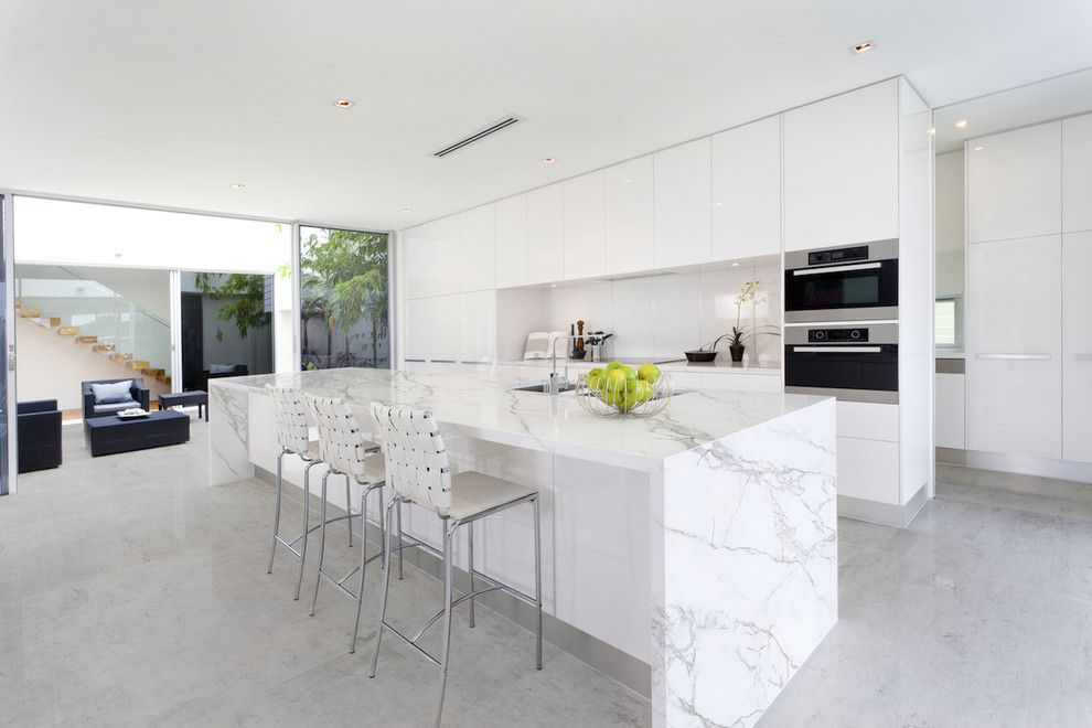 How to Clean Quartz Countertops for a Contemporary Kitchen with a Waterfall Countertop and Finished Projects by Omicron Granite & Tile