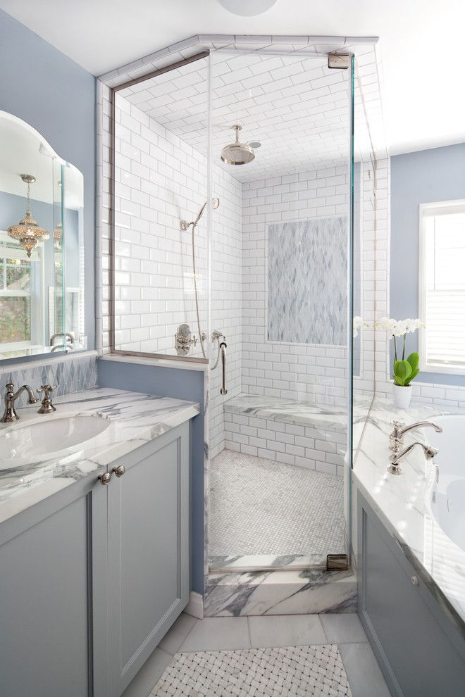 How to Clean Shower Grout for a Beach Style Bathroom with a Vanity and Shower at Master Bath by Lauren Shadid Architecture and Interiors