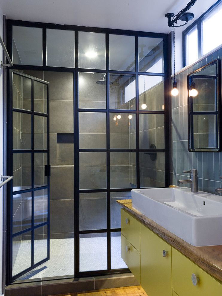 How to Clean Shower Grout for a Industrial Bathroom with a Raised Sink and Modern Bathroom by Robert Nebolon Architects