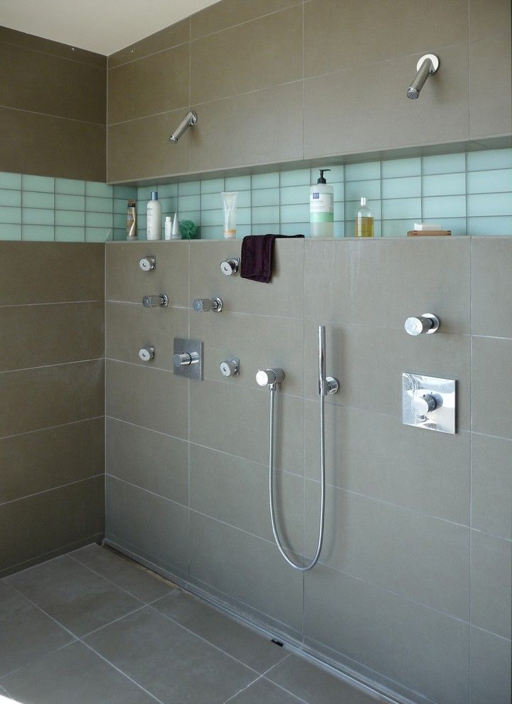 How to Clean Shower Grout for a Modern Bathroom with a Double Shower and Bodega Bay Master Bath by Oberhauser Interiors