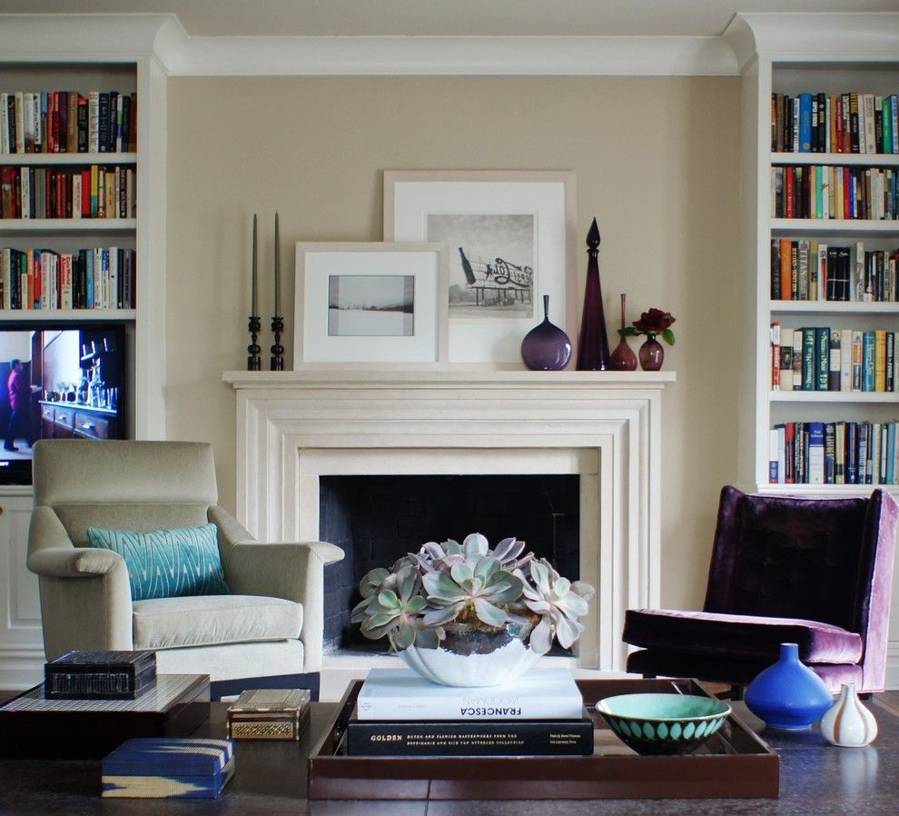 How to Decorate a Fireplace Mantel for a Traditional Living Room with a Purple Velvet Chair and a Modern Gem by Christopher Burns Interiors