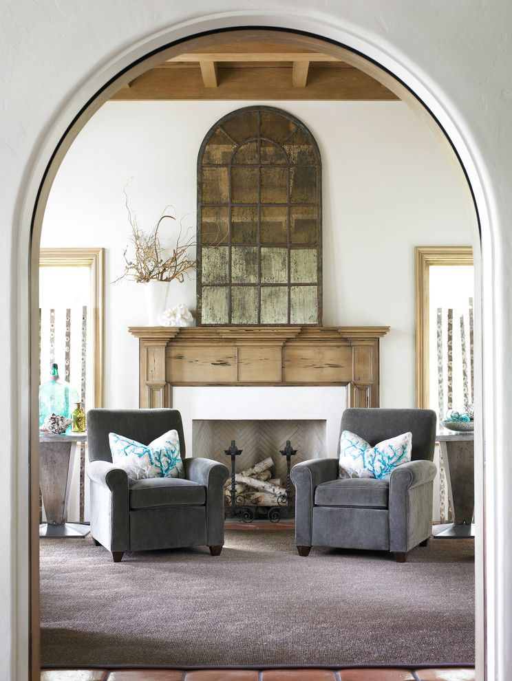 How to Decorate a Mantel for a Beach Style Entry with a White Fireplace Frame and Entry Sitting Area by Carter Kay Interiors