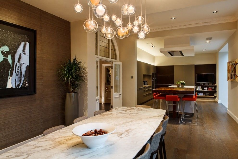 How to Dispose of Light Bulbs for a Contemporary Dining Room with a Lighting Design and a Custom Chandelier in the Dining Area by Brilliant Lighting