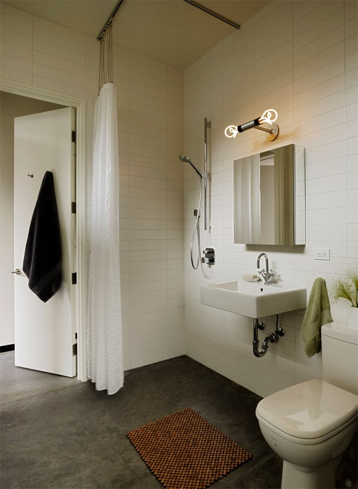 How to Dispose of Light Bulbs for a Modern Bathroom with a Wall Mirror and Modern Bathroom by Schwartzandarchitecture.com