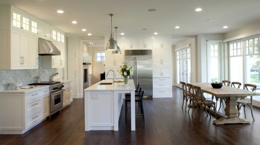 How to Dispose of Light Bulbs for a Traditional Kitchen with a Pendant Lighting and Kitchen by Charlie & Co. Design, Ltd