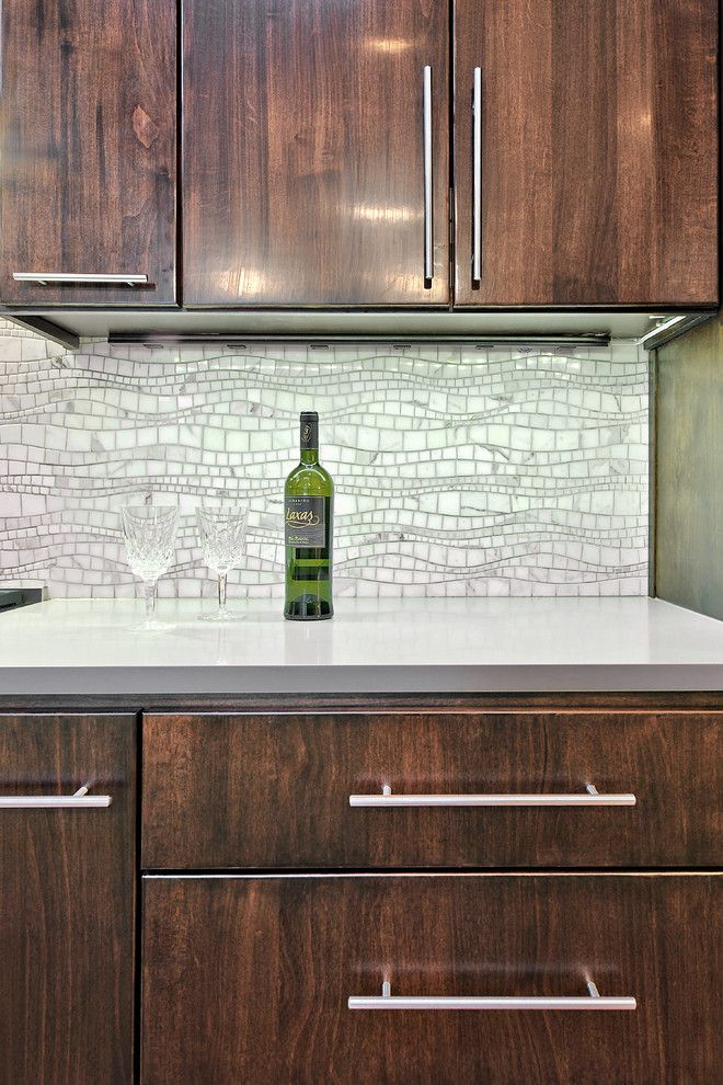 How to Install Backsplash for a Contemporary Kitchen with a Flat Panel Cabinets and Kitchen After by Realty Restoration, Llc