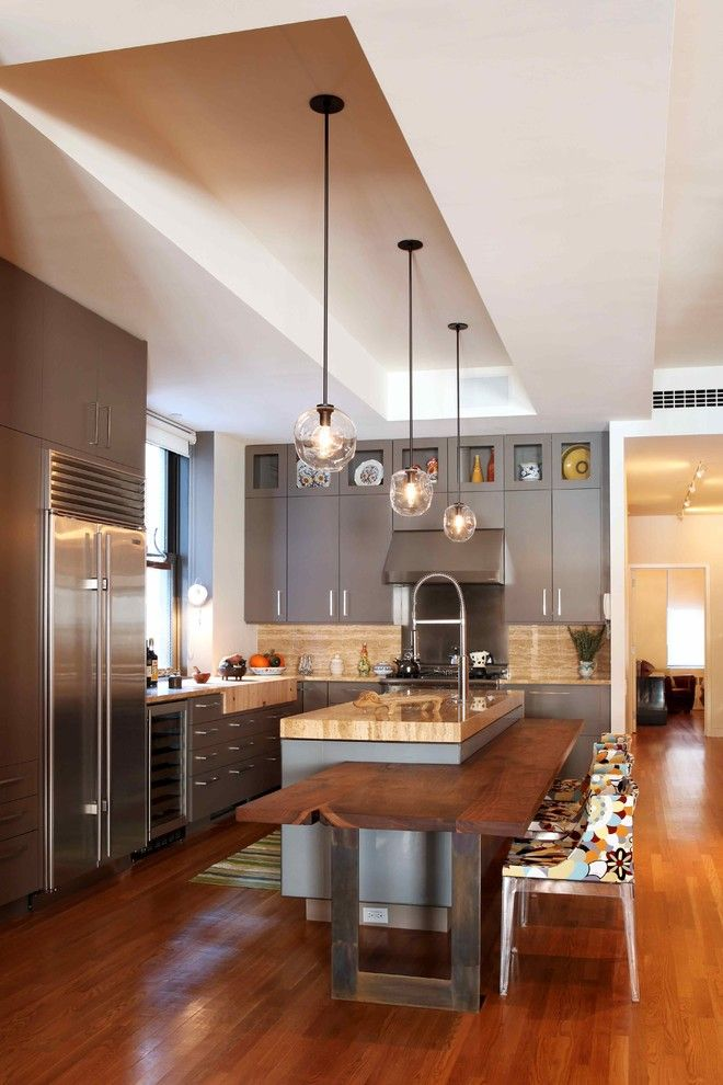 How to Organize Kitchen Cabinets for a Contemporary Kitchen with a Wood Floors and VP Interiors 2010 by Valerie Pasquiou Interiors + Design, Inc