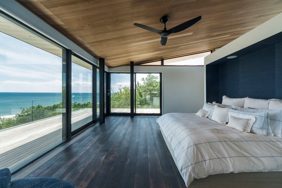 How to Patch Drywall for a Contemporary Bedroom with a Ceiling Fans and Fleetwood Distinguished Photos by Fleetwood Windows & Doors