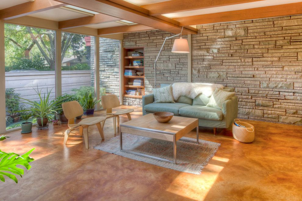 How to Stain Concrete Floors for a Midcentury Family Room with a Ceiling Beams and Christensen Remodeling by Genesis Architecture, Llc.