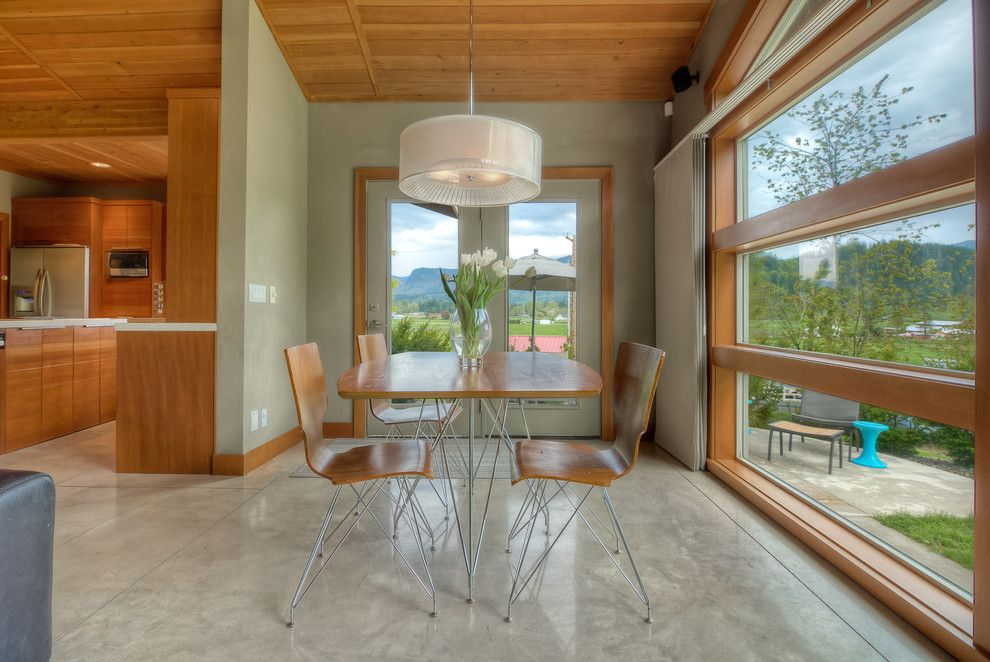 How to Stain Concrete Floors for a Modern Dining Room with a Green Walls and Modern Kitchen by Concept Builders, Inc.