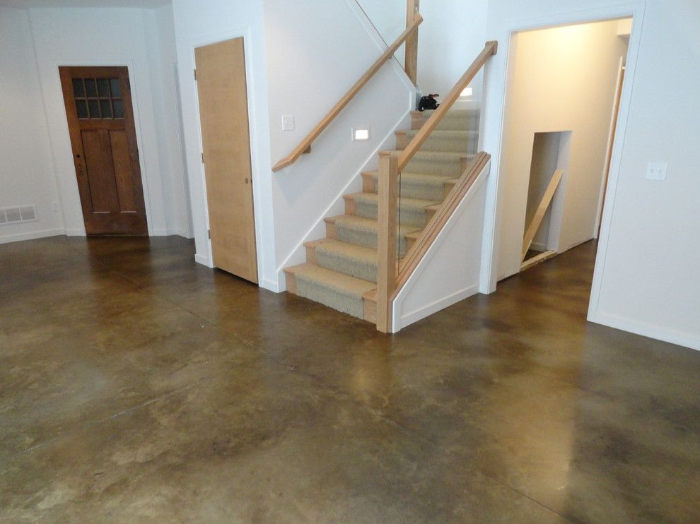 How to Stain Concrete Floors for a Traditional Basement with a Dyed Concrete and Stained Concrete Basement Floor by Dancer Concrete Design