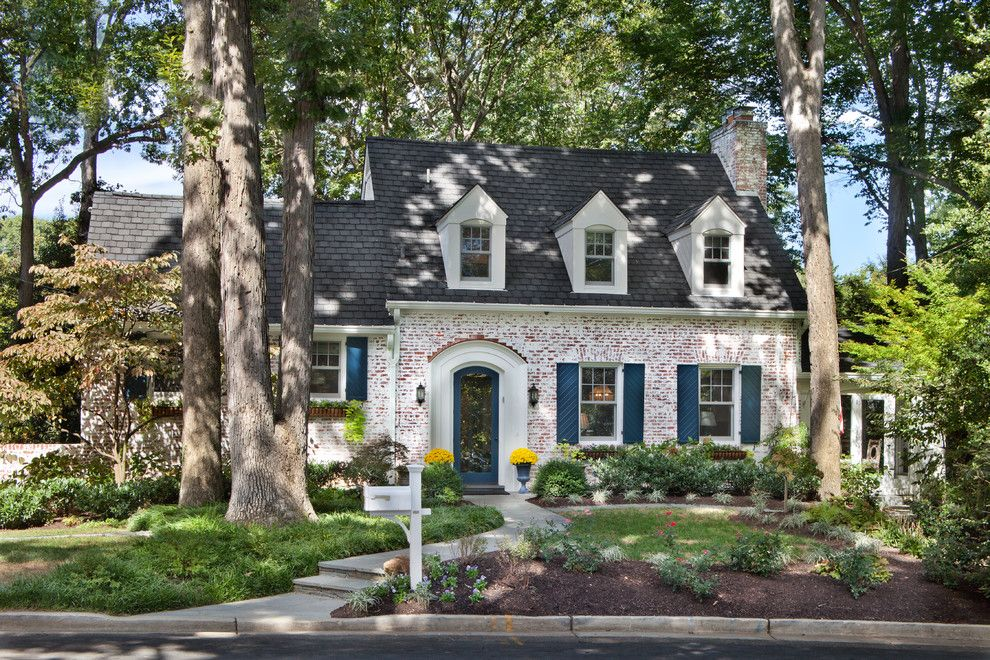 How to Whitewash Brick for a Traditional Exterior with a Shrubs and Trimmed to Perfection by Anthony Wilder Design/build, Inc.