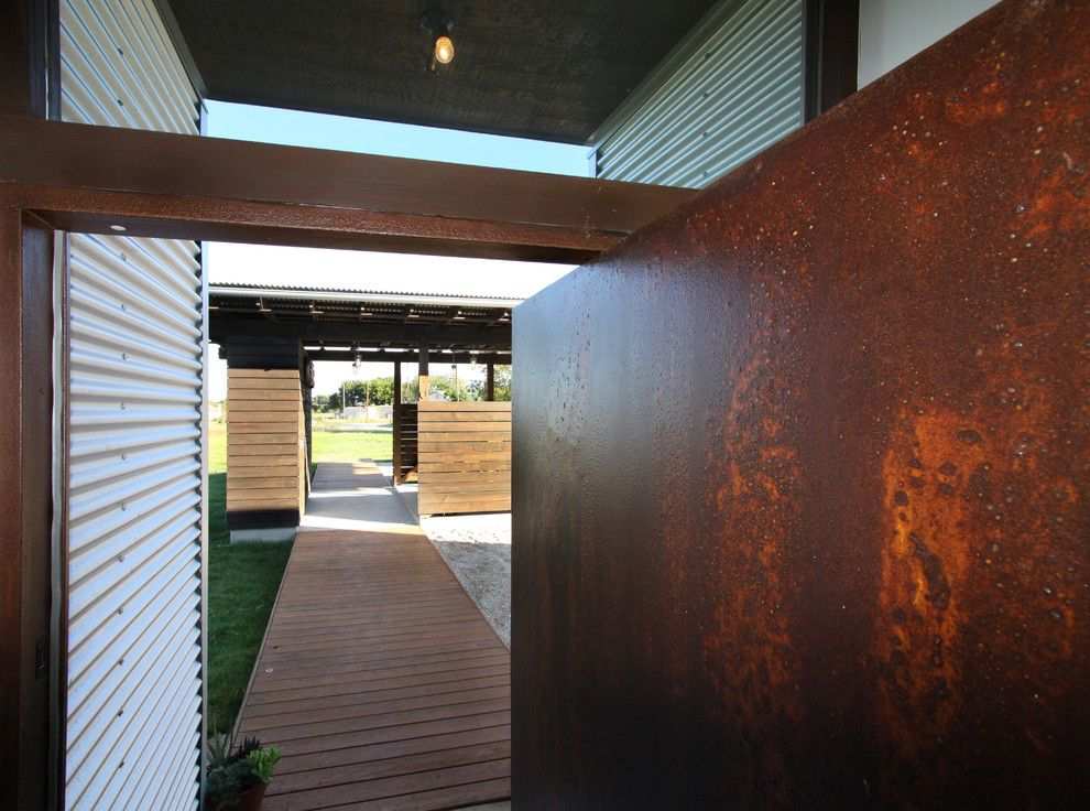 Humara for a Industrial Entry with a Pivot Door and Pivot Pad by Ignacio Salas Humara Architect Llc