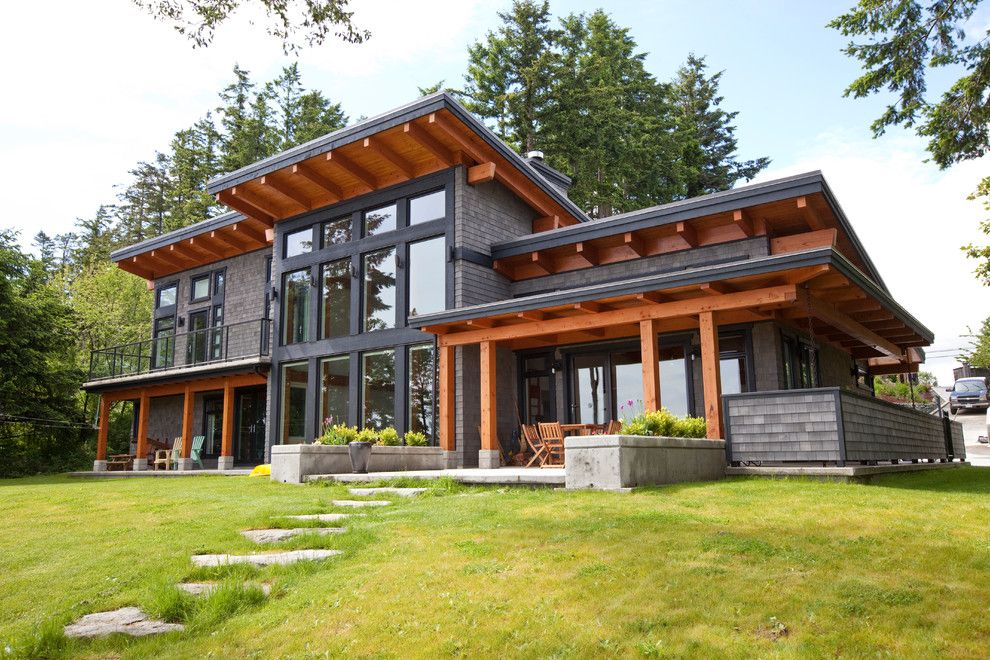 Hurricane Proof House for a Contemporary Exterior with a Rafters and Capturing the Beauty of Its Location. by Island Timberframe Ltd.